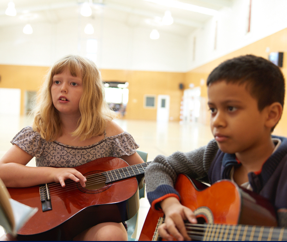 Students playing guitar music class